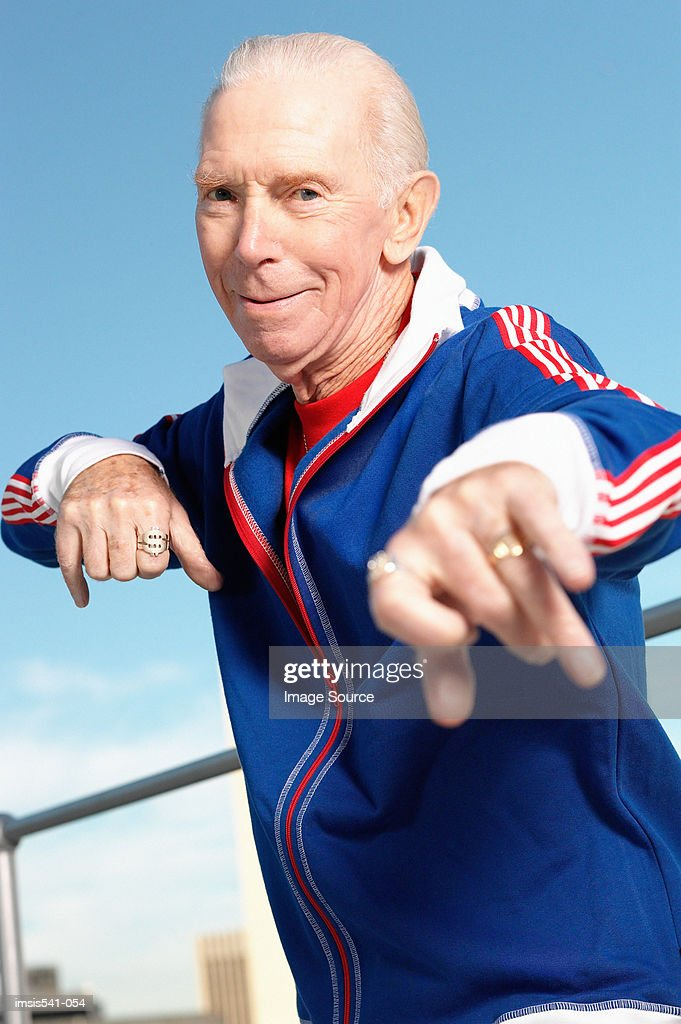 Elderly man posing in track suit : Foto de stock