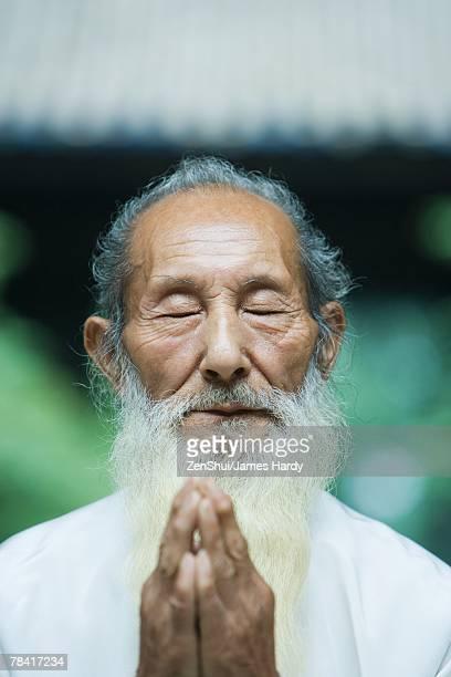 Elderly man praying