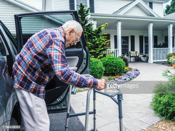 elderly man returning home resting with mobility walker - disembarking stock pictures, royalty-free photos & images