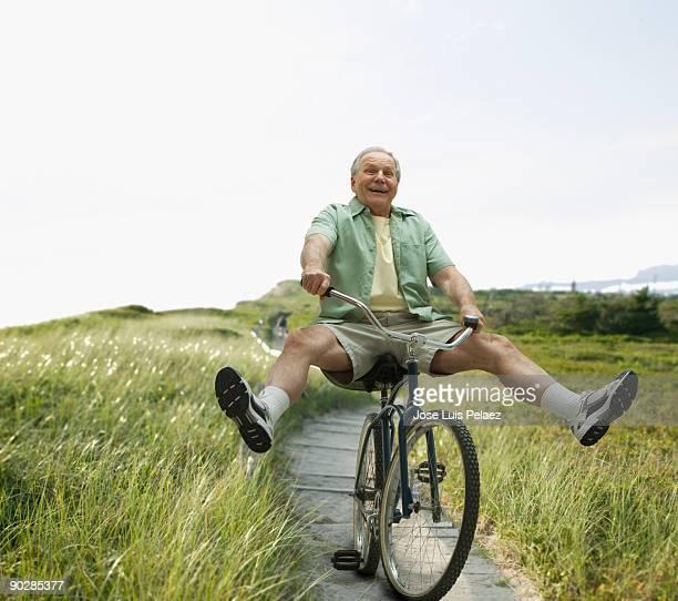 Elderly man riding bicycle
