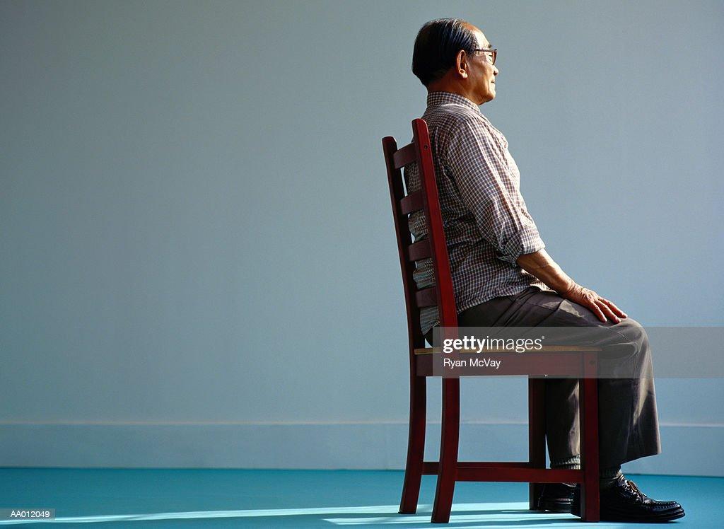 Elderly Man Sitting : Stock Photo