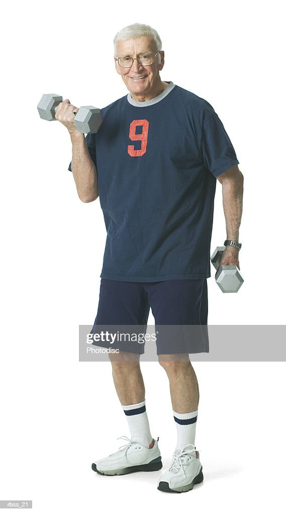 Elderly man smiles as he lifts weights. : Foto de stock