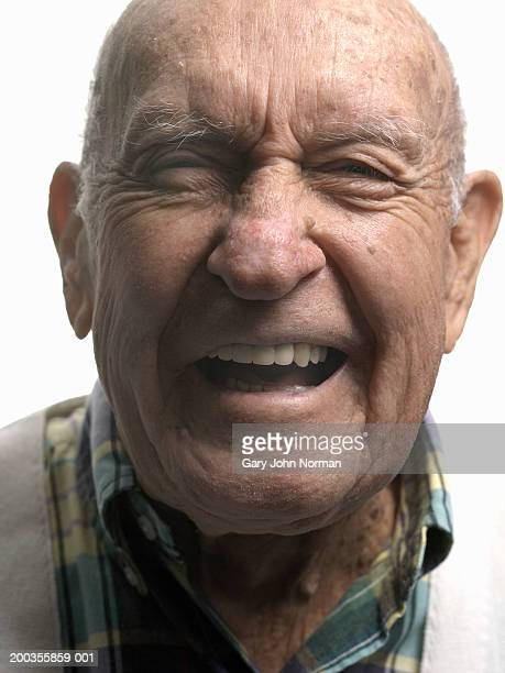 elderly man smiling, close-up - norman elder stock photos and pictures