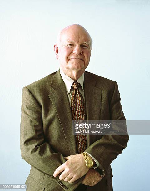 elderly man smiling, portrait - completely bald stock photos and pictures