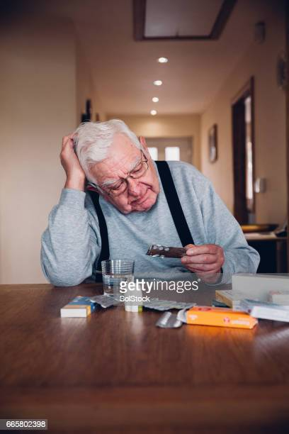 Elderly Man Taking his Medication