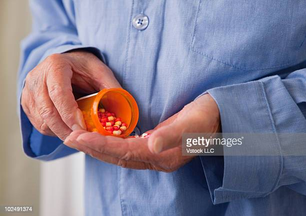 Elderly man taking prescription medication