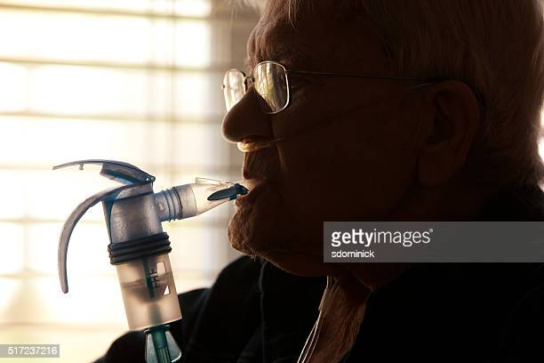 elderly man using nebulizer - copd stock photos and pictures