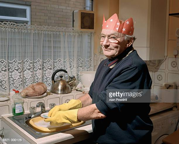 Elderly Man Washing Dishes