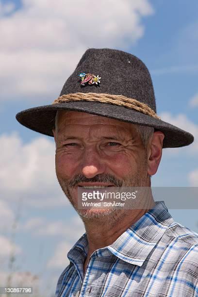 Elderly man wearing a Tyrolean hat, portrait, Karwendel, Austria, Europe