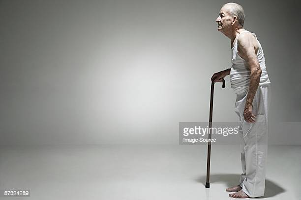 Elderly man with a walking stick