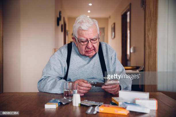 elderly man with all his medication - unhealthy living stock pictures, royalty-free photos & images