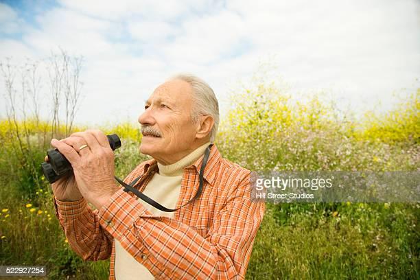 Elderly Man with Binoculars
