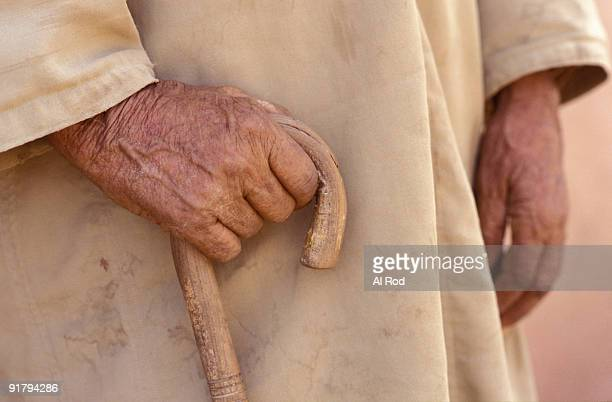 Elderly man with cane
