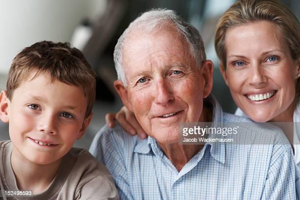 Elderly man with nurse and grandson