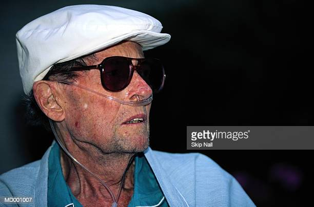 elderly man with oxygen tube - emphysema stock photos and pictures