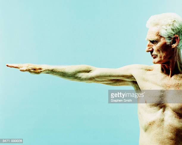 Elderly Man with Raised Arm