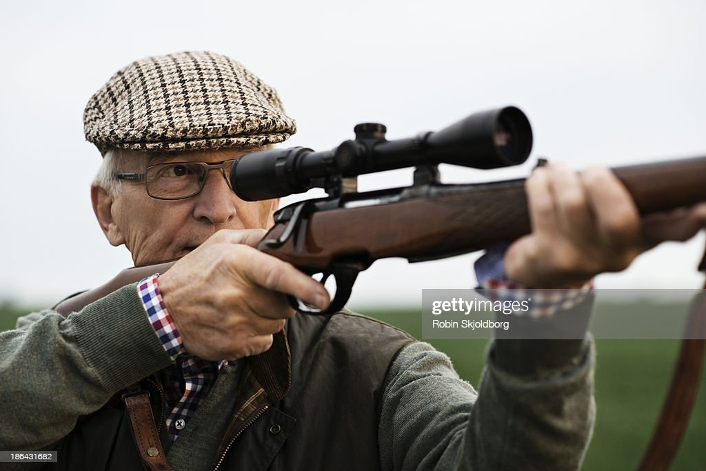 Elderly man with sixpence and riffle : Stock Photo