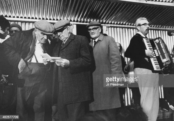 Elderly men exchange notes at the Egremont Crab Fair Cumberland September 1974