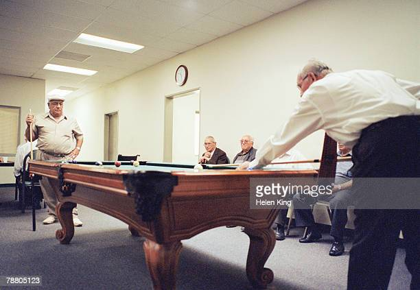 elderly men playing pool - old men playing pool stock pictures, royalty-free photos & images
