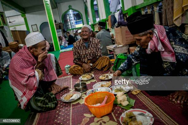 Elderly men prepare for a fasting break at a boarding school Sepuh Payaman that cares for the elderly during Ramadan on July 15 2014 in Magelang...