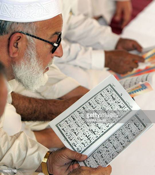 Elderly men read the Koran during a mourning service for assassinated Pakistani opposition leader Benazir Bhutto at her family residence in the Gulf...