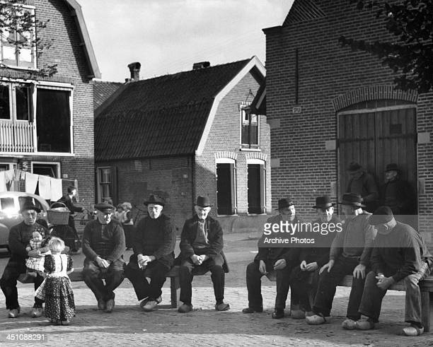 Elderly men sit in the Town Square in the fishing village of Spakenburg Holland Circa 1950