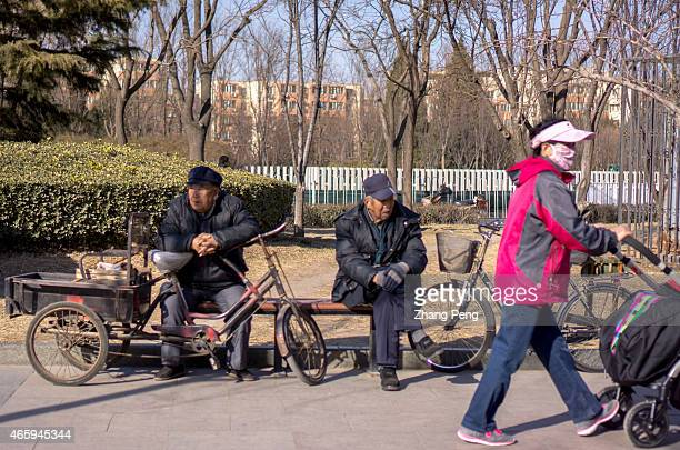 Elderly men sits in a park idling their time China's pension fund faces great pressure to break even in coming years The government will gradually...