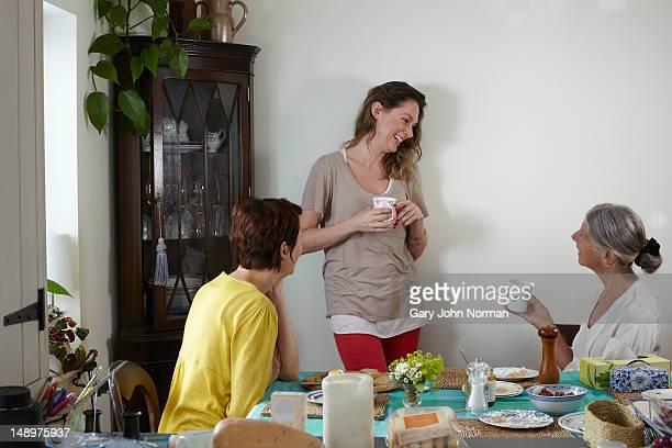 elderly mum and daughters  sharing breakfast