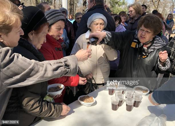 Elderly muscovists toast during the subbotnik at Sosenki park in Moscow Russia April 2018 Moscow government called Muscovits to take part in the...