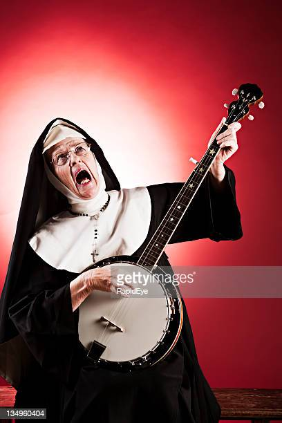 elderly nun gets her groove on to banjo backing! - nun stock pictures, royalty-free photos & images