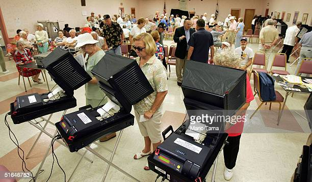 Elderly oters cast their ballots on the new touchscreen electronic voting machines in the Century Village retirement community in Palm Beach County...