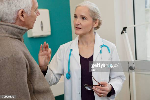 elderly p. consulting, dialogue - colorectal cancer stock photos and pictures
