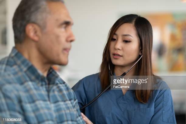 elderly patient home visit - body care stock pictures, royalty-free photos & images