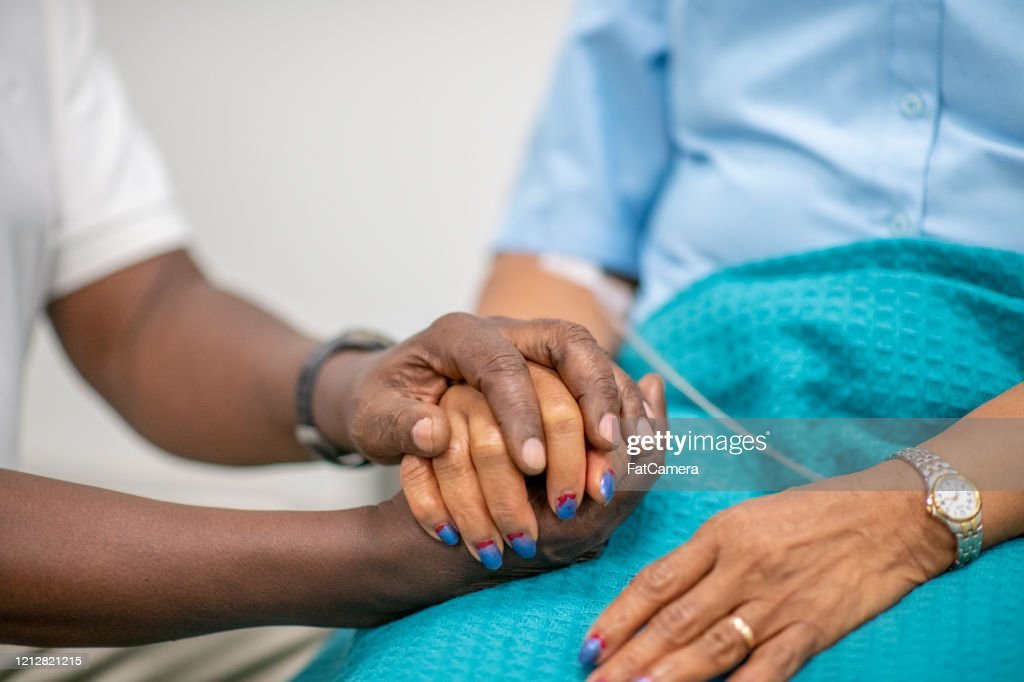 Elderly Patient is Comforted by Medical Personnel stock photo : Stock Photo