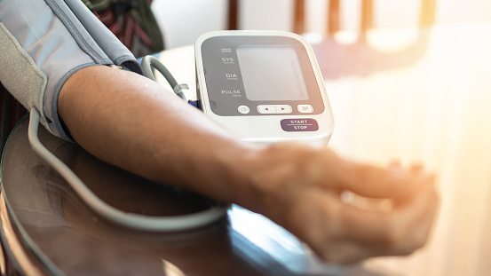 Elderly patient with bp, heart rate, digital pulse check equipment for medical geriatric awareness in stroke systolic high blood pressure, hypertension, hypotension and cardiovascular disease in aged senior older woman person 1177942982