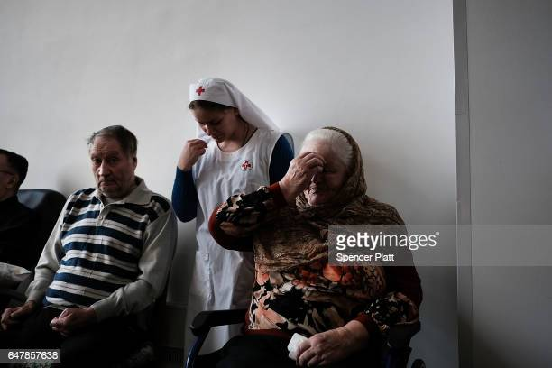 Elderly patients and their nurses in a Moscow nursing home attend Orthodox mass on March 4 2017 in Moscow Russia The home which houses nearly 20...