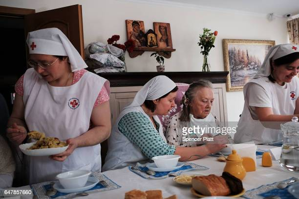 Elderly patients are fed by a nurses following Orthodox mass in a Moscow nursing home on March 4 2017 in Moscow Russia The home which houses nearly...