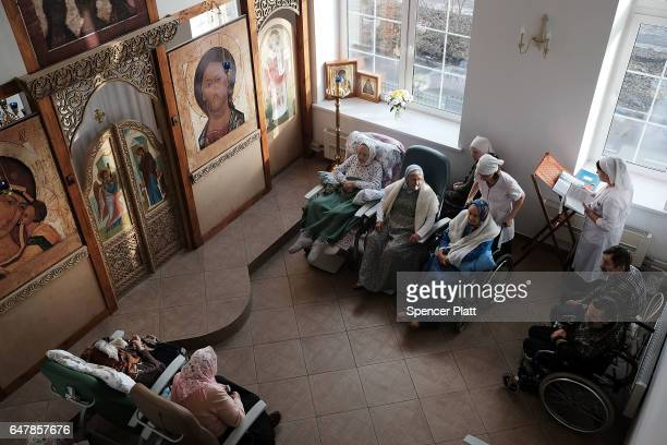 Elderly patients in a Moscow nursing home attend Orthodox mass on March 4 2017 in Moscow Russia The home which houses nearly 20 patients who were...
