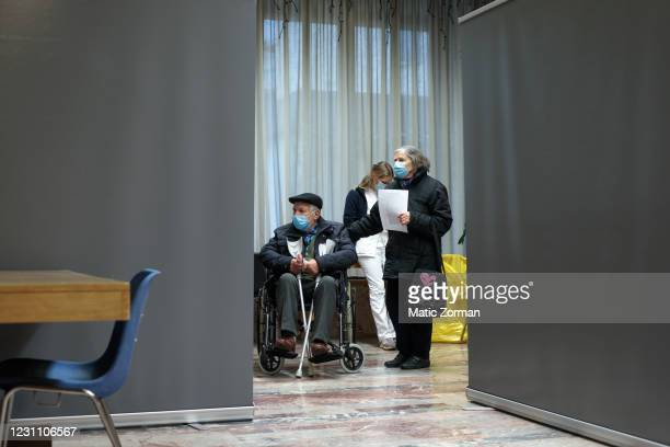 Elderly people above 80 years of age who registered for vaccinations wait in line to get vaccinated on February 11, 2021 in Kranj, Slovenia. Slovenia...