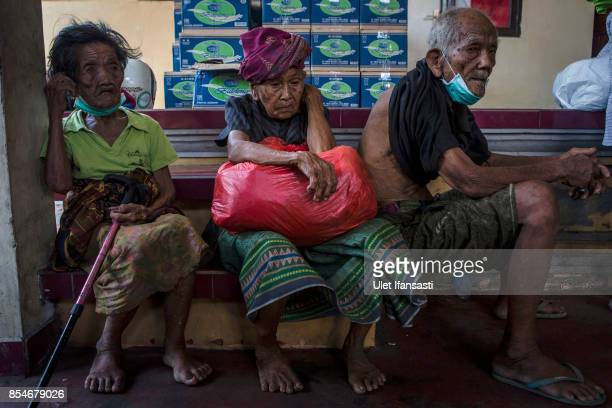 Elderly people are seen at temporary shelter after being evacuated from their village at Penuktukan village on September 27 2017 in Buleleng regency...
