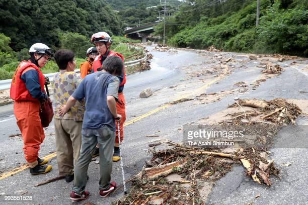 Elderly people evacuate with fire fighters after heavy rain on July 7 2018 in Hiroshima Japan 51 people were killed and 58 missing The deluge...