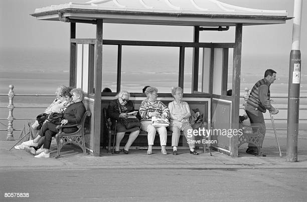 Elderly people in a shelter on the seafront at Blackpool Lancashire 27th September 1998