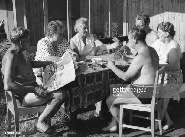 Elderly people playing cards austria 1962