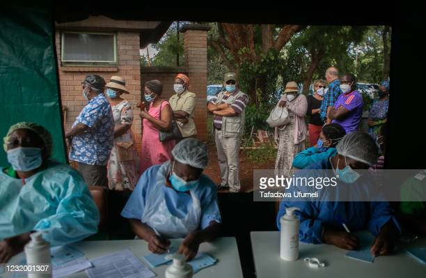 Elderly people queue for the Sinopharm vaccination outside the tent whilst nurses conduct their duties at a local hospital on March 29, 2021 in...