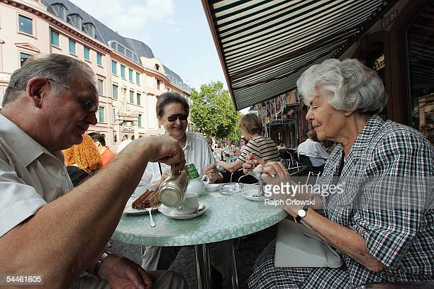 Elderly people rest in a cafe on September 3 2005 in Mainz Germany Germany's economy and pension system is being burdened by an expanding elderly...