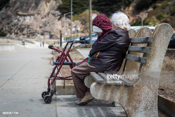 Elderly people sit on a bench at Ocean Beach in San Francisco California US on Thursday June 21 2018 The Labor Department rule aka the fiduciary rule...