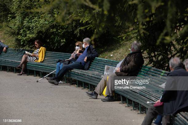 Elderly people sit on the world's longest bench on April 21, 2021 in Milan, Italy. Located at Parco Industria Alfa Romeo , the 208 meters long...