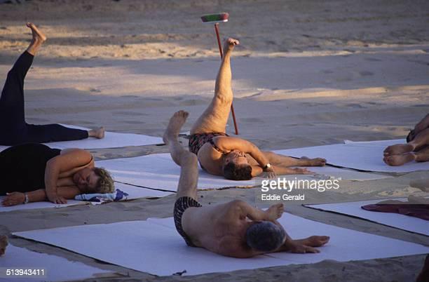 Elderly people stretching in Frishman beach Tel Aviv Israel