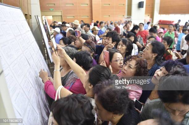 Elderly woman writes down a blind date message during a blind date event for chinese valentine's day on August 17 2018 in Harbin ChinaMore and more...