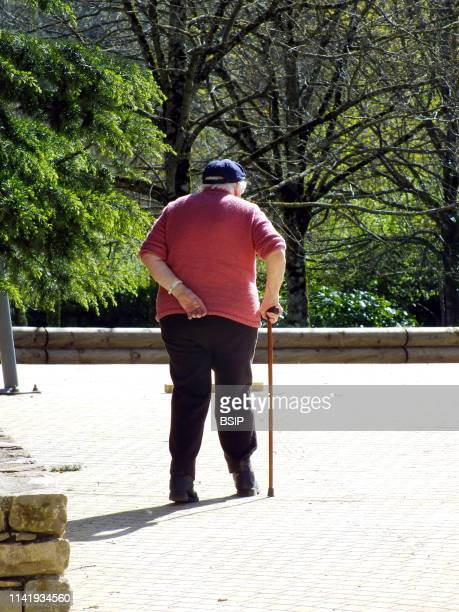 Elderly person going for a walk.